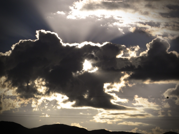 Albuquerque Balloon Fiesta Special Shapes sun behind the clouds