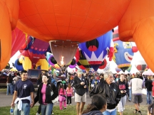 Albuquerque Balloon Fiesta Special Shapes underneath balloons and pilot hitting their burner