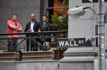 Corporate suits watching from their balcony