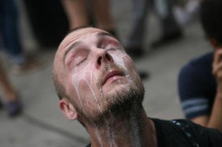Man having eyes flushed out from pepper spray