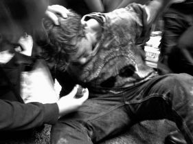 Occupy Wall Street man on ground being arrested being given an inhaler 01
