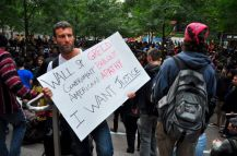 Occupy Wall Street sign I want Justice greed apathy