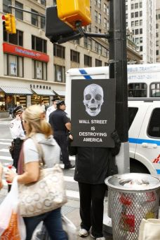 Occupy Wall Street skull sign Wall Street is destroying America