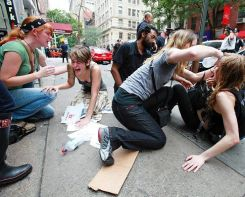 Photo of the women who were pepper sprays on Sept 17th getting assistance by fellow protestors
