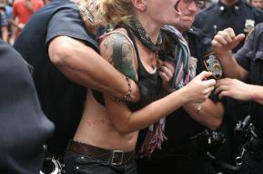 Police officer grabbing female protestor