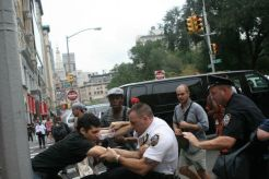 Police officer pulling protestor