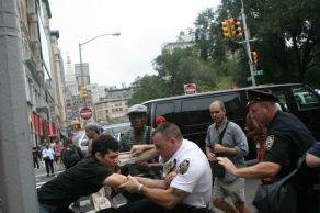 Police officer pulling protestor