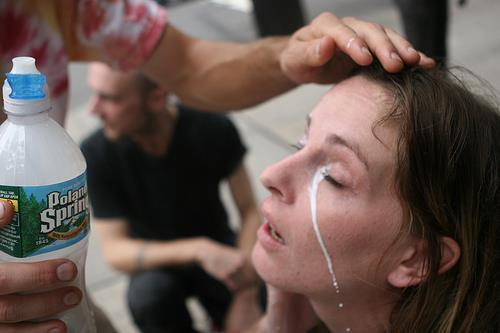 Rinsing eyes sprayed with pepper spray