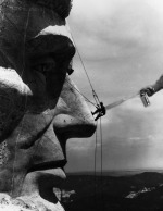 Lt John Pike pepper spraying cop spraying sculpture on Mt Rushmore