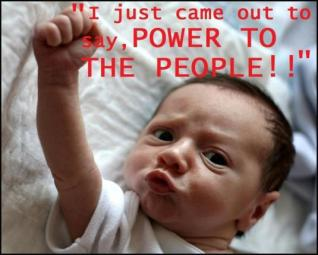 Baby with fist Power to the People OWS