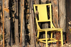 jpeg untouched Yellow chair in front of fence 01