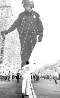 Lt John Pike pepper spraying cop as large balloon in Macy's Day parade