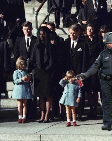 pepper spraying cop John Pike spraying John Jr and Kennedy's funeral
