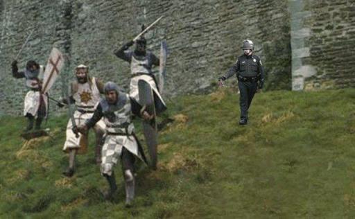 pepper spraying cop John Pike spraying Monty Pythons the Holy Grail knights