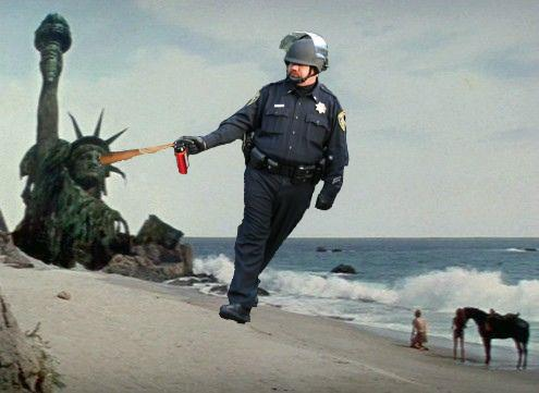 http://llwproductions.files.wordpress.com/2011/11/pepper-spraying-cop-john-pike-spraying-statue-of-liberty-in-planet-of-the-apes.jpg