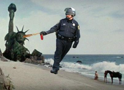 pepper spraying cop John Pike spraying statue of liberty in Planet of the Apes