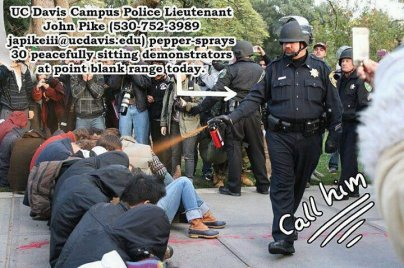 UC Davis police lieutenant John Pike pepper spraying student prosters phone number and email address for Pike