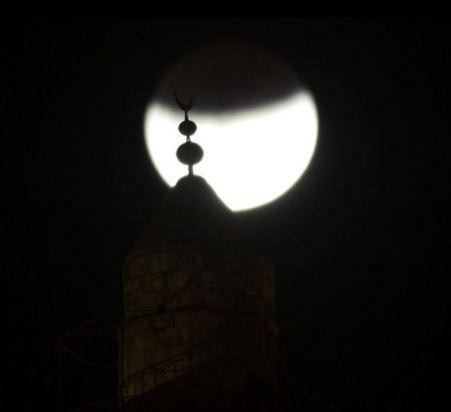 A mosque above Jerusalem's Old City. (Photo credit: MENAHEM KAHANA/AFP/Getty Images)