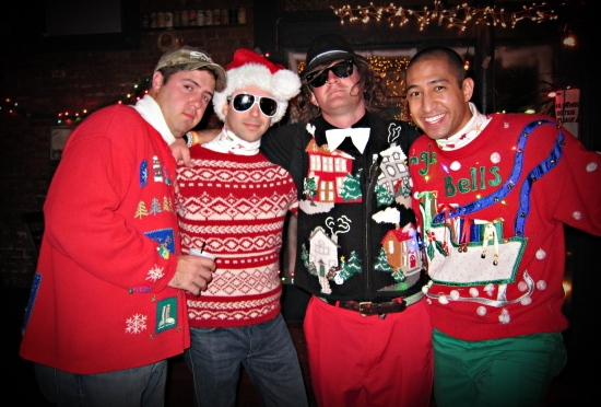 Four guys in ugly Christmas sweaters