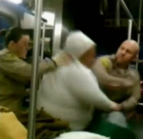 Cop punches handicapped woman on bus