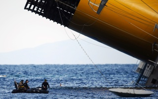 Rescuers check the sea near the Costa Concordia on January 15, 2012, after the cruise ship ran aground the night before. (Filippo Monteforte/AFP/Getty Images)