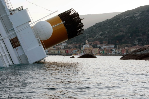 The Costa Concordia leans on its side after running aground, on January 14, 2012. (AP Photo/Gregorio Borgia)