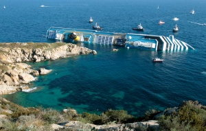 The Costa Concordia, surrounded by smaller boats, on Saturday, January 14, 2012, after running aground. (AP Photo/Gregorio Borgia)