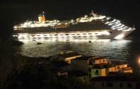 The luxury cruise ship Costa Concordia leans after it ran aground off the coast of the Isola del Giglio island, Italy, early Saturday, January 14, 2012. (AP Photo/Giglionews.it, Giorgio Fanciulli)