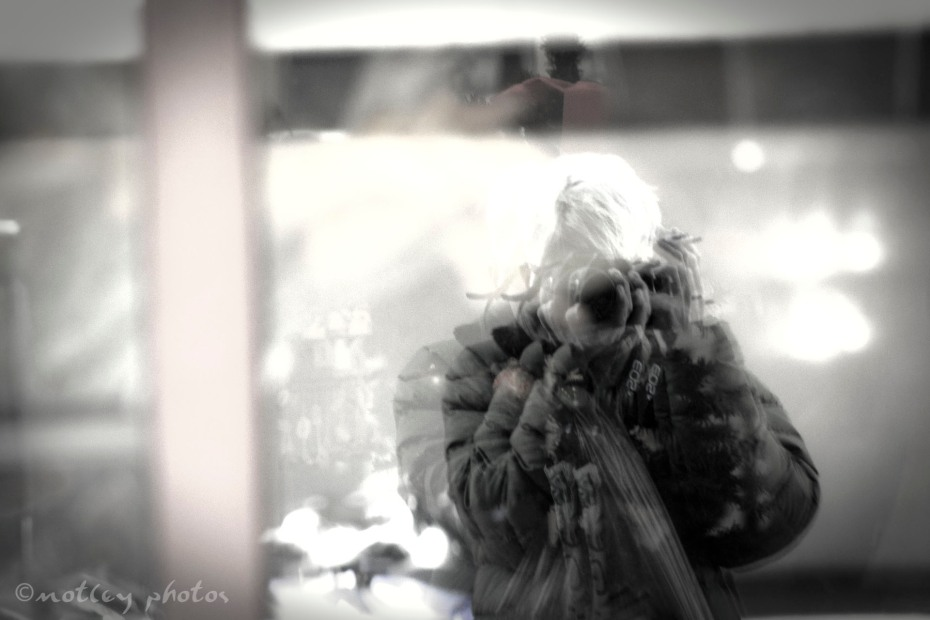 January 05, 2012: A photo of a reflection of myself in a downtown Albuquerque NM window.