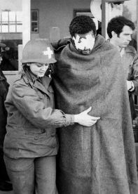 Historical photo Santa Fe Old Main prison injured prisoner being helped out