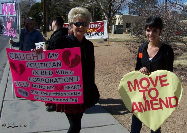 Hump Day photo_Occupy Albuquerque sign caught my politician in bed with corporation