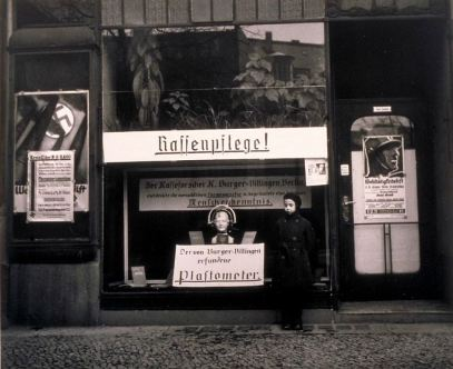 Nazi propaganda in Berlin storefront, including anthropometric device for measuring differences between Aryan and Non-Aryan skulls