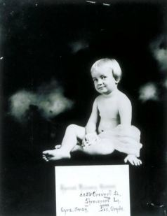 Six-year old Better Babies contestant, Louisiana State Fair, Shreveport including receiving physical exam and posing with prize ribbons
