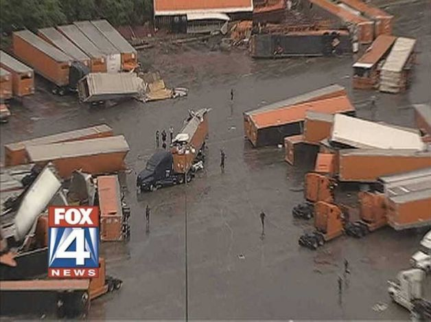 This frame grab provided by KDFW-TV shows tornado damage at the Flying J truck Tuesday in Lancaster, Texas. Several reported tornadoes tore through the Dallas area on Tuesday, tossing semis in the air and leaving crumpled tractor trailers strewn along highways and in truck stop parking lots. (AP Photo/KDFW-TV) Photo: AP / SL