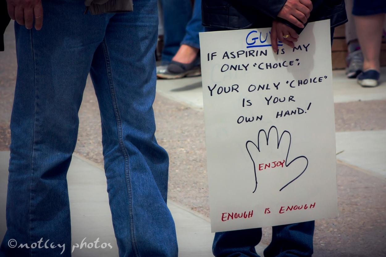 War on Women Santa FE NM 01 Aspirin choice and hand sign
