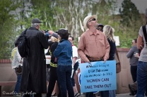 War on Women Santa FE NM 12 man holding sign women brought in politicians women can take them out