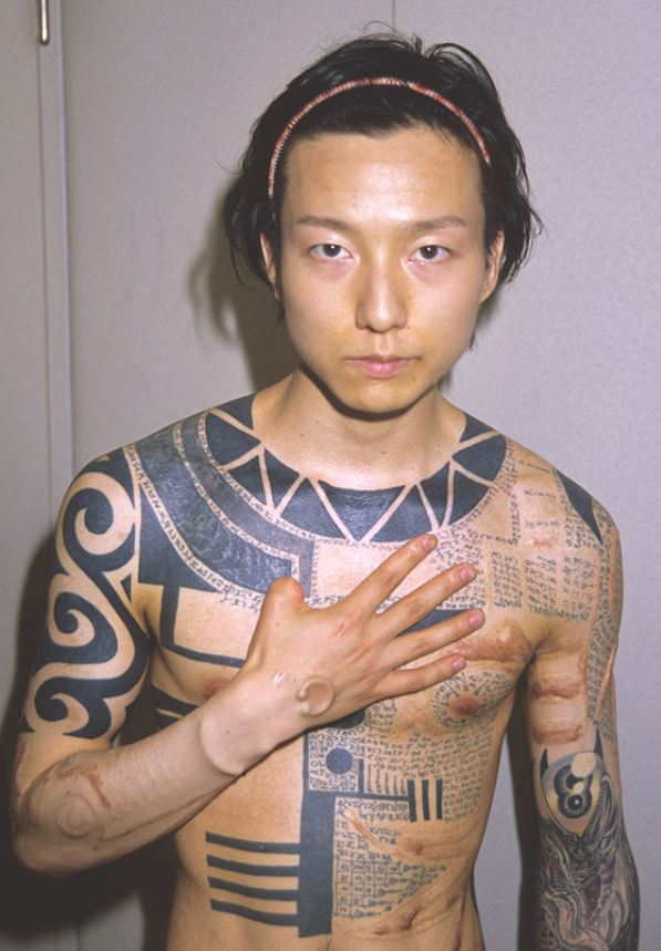 Man showing his body modifications Japan 1