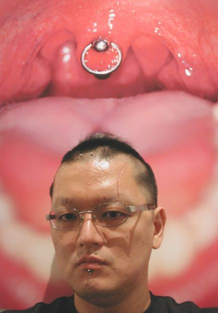 Pierced thing in mouth body modification Japan 1