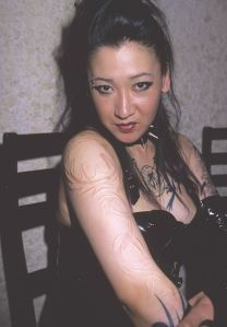 Body scar art on her arm after healing