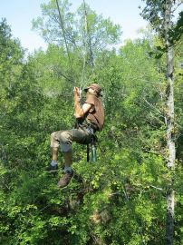 Stop the Keystone XL Pipeline_tree top activists traversing man