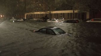 A vehicle is submerged on 14th Street near the Consolidated Edison power plant, Monday, Oct. 29, 2012, in New York.