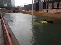 Sandy flooded taxi completely submerged