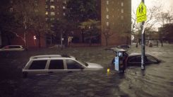 Vehicles are submerged on 14th Street near the Consolidated Edison power plant, Monday, Oct. 29, 2012, in New York. (AP)