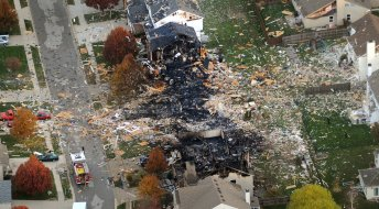 AFTER: Aerial view of south side Indy homes after explosion. (AP Photo/The Indianapolis Star, Matt Kryger)