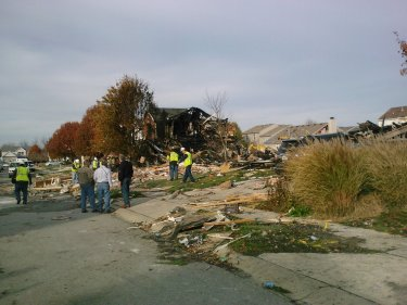 The morning after the homes burned down from fire from explosion.