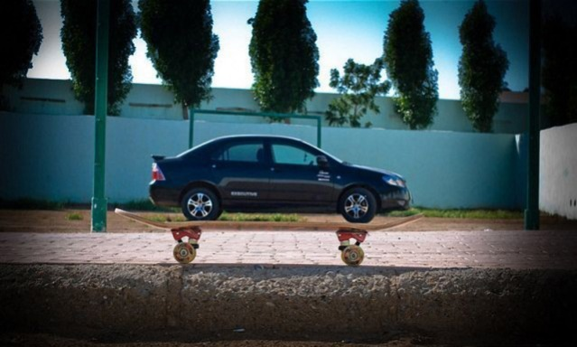 optical illusions car on top of skateboard