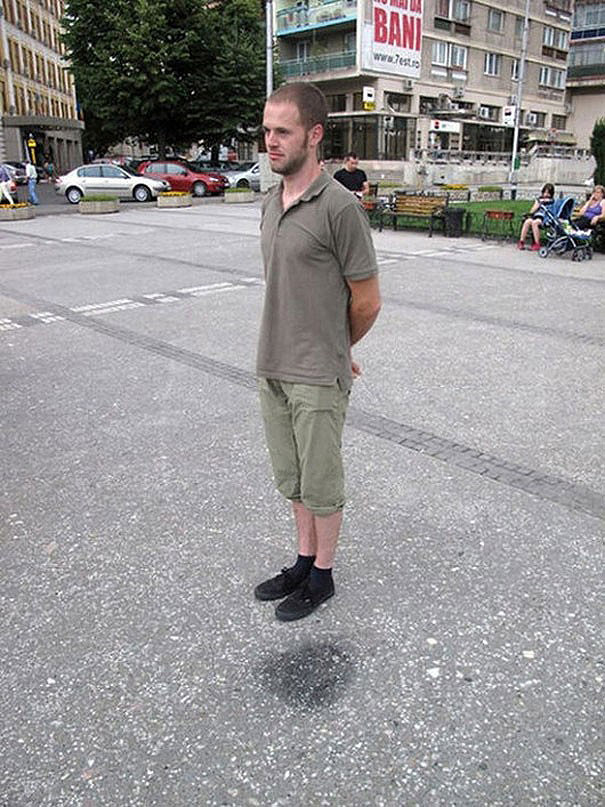 optical illusions man floating in the air