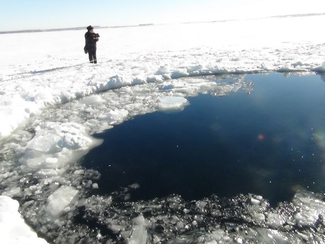 Friday, Feb. 15, 2013: A circular hole in the ice of Chebarkul Lake where a meteor reportedly struck the lake near Chelyabinsk, about 930 miles east of Moscow, Russia. Source: AP2013