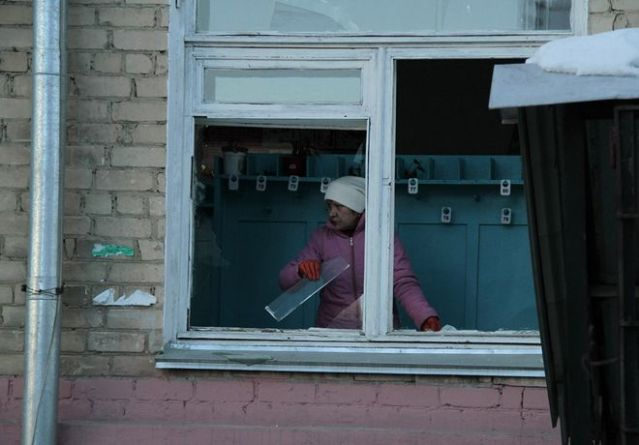 Feb. 15, 2013: In this photo provided by Chelyabinsk.ru, a woman cleans away glass debris from a window after a meteorite explosion over Chelyabinsk region. (AP Photo/ Yevgenia Yemelyanova)Source: AP2013