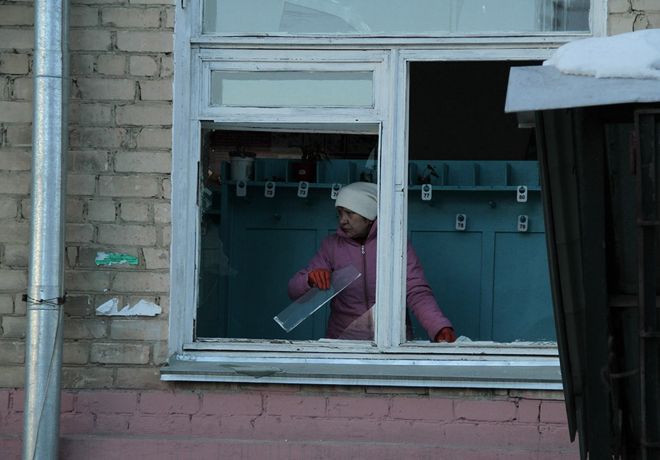 Feb. 15, 2013: In this photo provided by Chelyabinsk.ru, a woman cleans away glass debris from a window after a meteorite explosion over Chelyabinsk region. (AP Photo/ Yevgenia Yemelyanova)Source: AP2013